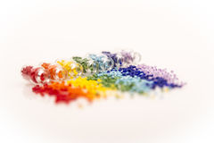 Tiny glass bottles with a rainbow of beads Stock Photos