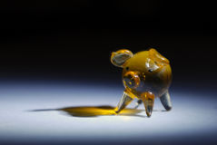 Tiny glass pig. Tryouts with my new objective Micro-Nikkor 105mm. The object is a small pig made of glass in the white light Royalty Free Stock Photo