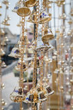 Tiny Gold Bells with Writing Royalty Free Stock Photography