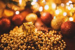 Tiny Gold Christmas Gift Royalty Free Stock Photos