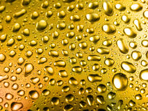 Tiny gold water drops Royalty Free Stock Image