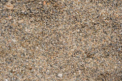 Tiny grains of sand macro close up texture. Stock Photo