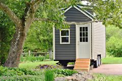 Free Tiny Gray House On Wheels Stock Photo - 119994660