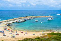 The tiny haven. The small haven with the cozy beach, many boats and yachts located next to the Agios Georgios at Pegeia, Cyprus stock photos