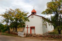Church in Canoncito, New Mexico. The tiny historic church of Nuestra Senora de la Luz located 12 miles southeast of Santa Fe, New Mexico in the hamlet of Stock Photography