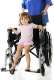 Tiny Hospital Patient in a Discharge Wheelchair Royalty Free Stock Photos