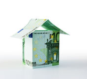 Tiny house from euro Royalty Free Stock Image