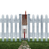 Tiny House. And small home concept as a confined residence real estate symbol as a very narrow family house between a picket fence as a metaphor for living in a Stock Photo