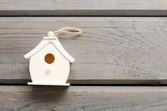 Tiny house on wooden background Royalty Free Stock Photography