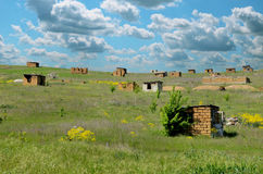 Tiny huts in the field. Unfinished houses, occupying territory Royalty Free Stock Images