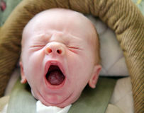 Tiny Infant with Big Yawn Stock Photos