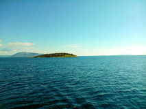 A tiny island the Ionian sea. Blue sea and sky in Greece Royalty Free Stock Image