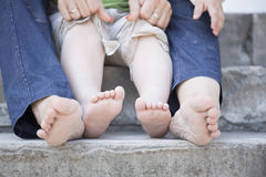Tiny legs of  child and his mother Stock Photos