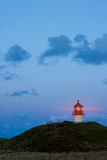 Tiny lighthouse by night Royalty Free Stock Photo
