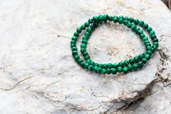 The tiny Malachite Bracelet. On the stone royalty free stock photo