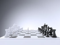 Tiny man on a chess board Royalty Free Stock Photos