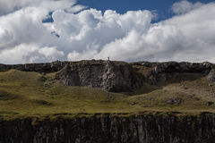 Tiny man on a clif. In iceland Stock Images