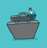 Tiny man engaging in business opportunity entering a suitcase or Stock Image
