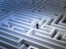Tiny man in a maze Stock Photo