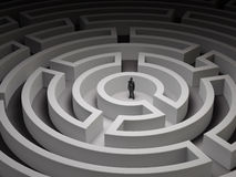 Tiny man in a maze Stock Photo