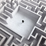 Tiny man in a maze Royalty Free Stock Photos