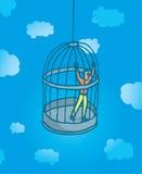 Tiny man prisoner on bird cage Royalty Free Stock Image