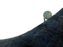 Tiny man pushing a ball of money up hill stock image