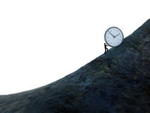 Tiny man pushing a clock up hill Royalty Free Stock Photo