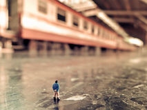 Tiny miniature people and train. Tiny miniature people looking train Royalty Free Stock Photography