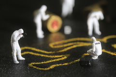 Tiny Miniature Scaled People in Curious Concepts Royalty Free Stock Photo