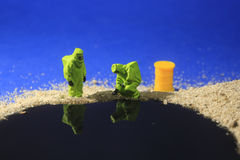 Tiny Miniature Scaled People in Curious Concepts Royalty Free Stock Photography