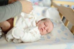Tiny newborn. Mother take care of tiny newborn Stock Image