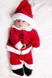 Tiny newborn in santa claus suit Stock Photos