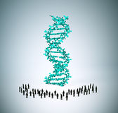 Tiny people around a DNA strand Royalty Free Stock Photos