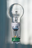 Tiny people in a balloon made from a light bulb. The concept of Royalty Free Stock Image