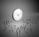 Tiny people clock. Tiny people walking to a large clock Royalty Free Stock Photography