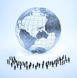 Tiny people and Earth Stock Image