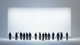Tiny people looking at an empty. A group of tiny people looking at an empty ad board or painting Royalty Free Stock Image