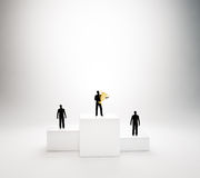 Tiny people on a podium Stock Image