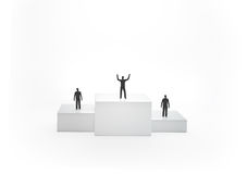 Tiny people on a podium Stock Photos