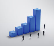 Tiny people standing around a bar graph. Teamwork and company profits concept Royalty Free Stock Photography