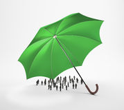 Tiny people under an umbrella Royalty Free Stock Photo