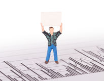 Tiny person demonstrating on a graph Stock Photo