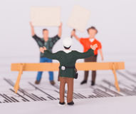 Tiny person demonstrating on a graph, selective focus Stock Image
