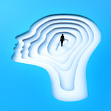 Tiny person standing inside a head silhouette. Tiny person standing inside a female head silhouette Royalty Free Stock Images