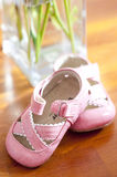 Tiny pink shoes for baby girl Stock Photos