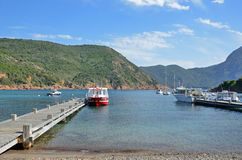 Tiny port Girolata in the natural harbour, Corsican coast Stock Images