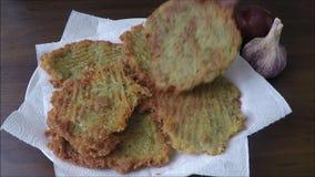 Tiny potato pancakes on plate stock footage