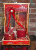 Tiny red Buddhist altar with incense sticks Royalty Free Stock Photos