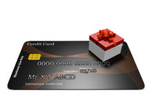 Tiny Red Gift Box on Credit Card Stock Images
